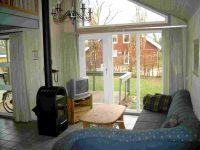 Wohn / Esszimmer mit TV und Kamin